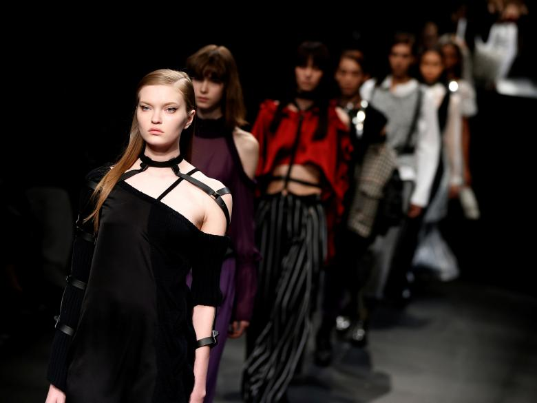 Models present creations by designer Yukimi Kawashima from her Autumn/Winter 2017 collection for her brand AULA during Tokyo Fashion Week in Tokyo